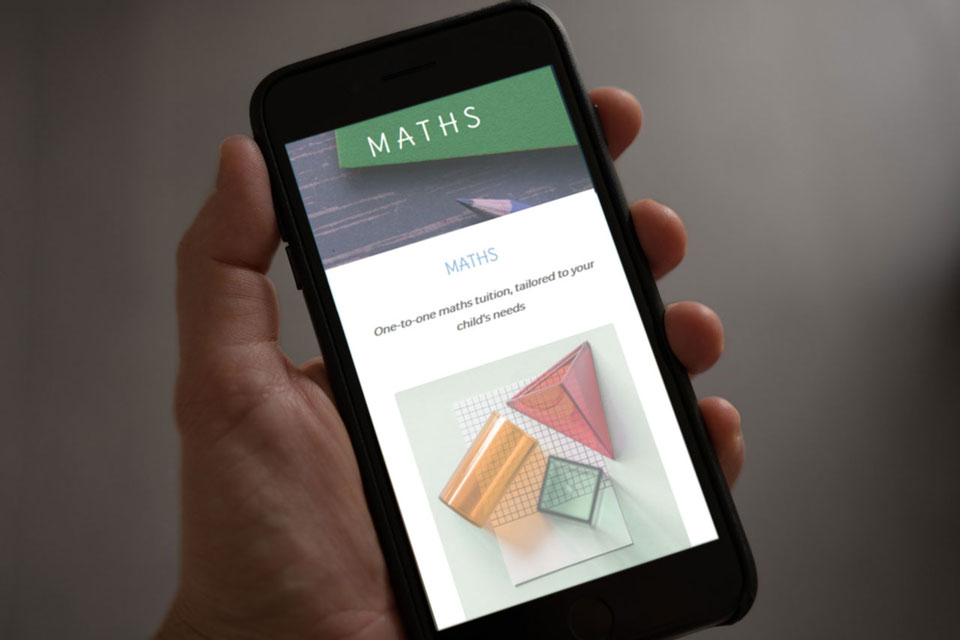 Maths tuition website shown on a mobile phone